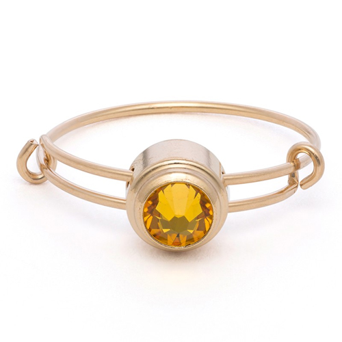 The yellow Alex and Ani Sacred Studs ring
