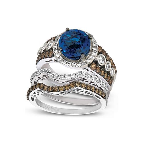 This chocolate diamond engagement ring has a center blue diamond.