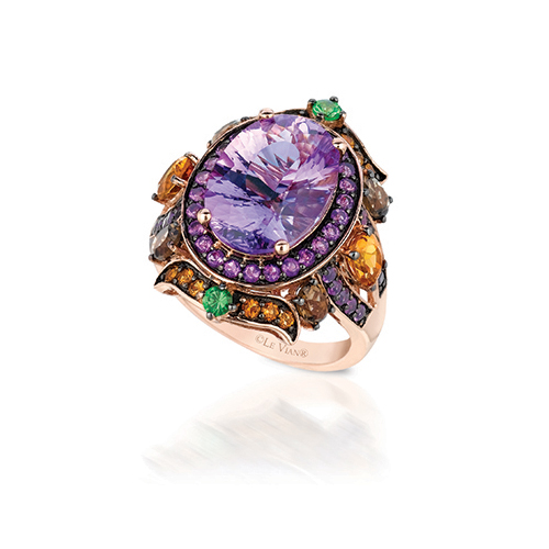 Diamond ring featuring colored diamonds including purple diamonds.