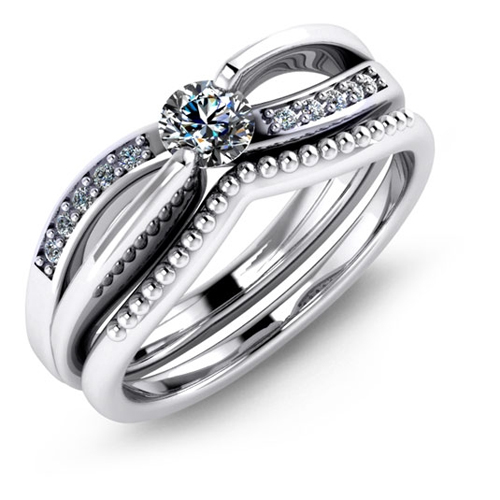Matching engagement ring and wedding band from Malo.