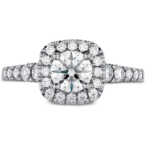 You can use a cushion diamond engagement ring setting and use a round diamond.