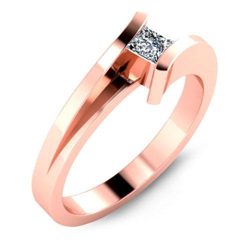 Rose gold bezel diamond engagement ring.