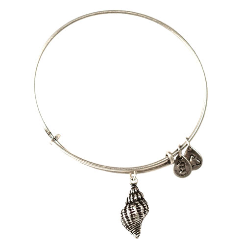 The Conch Charm bangle is available in both gold and silver.