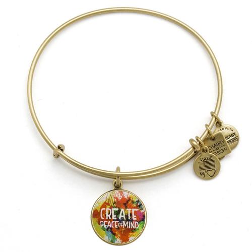 Peace bangle bracelet was designed by Alex and Ani.