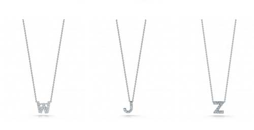 Robert Coin initial diamond encrusted pendants.