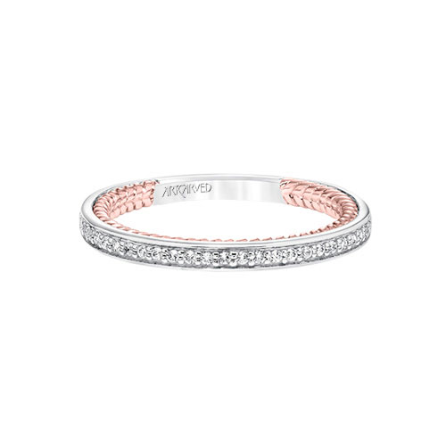 The diamonds go all around the wedding band on this ArtCarved beauty.