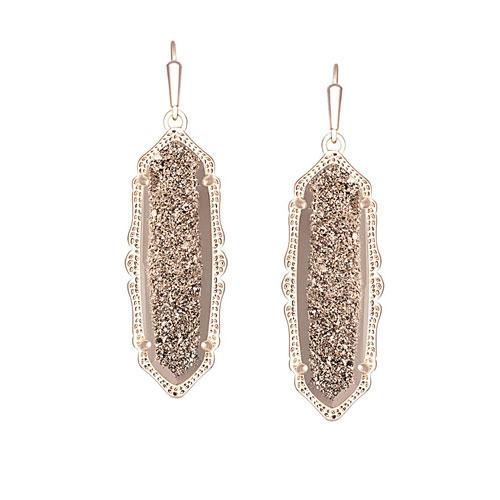 Kendra Scott designs earrings also.