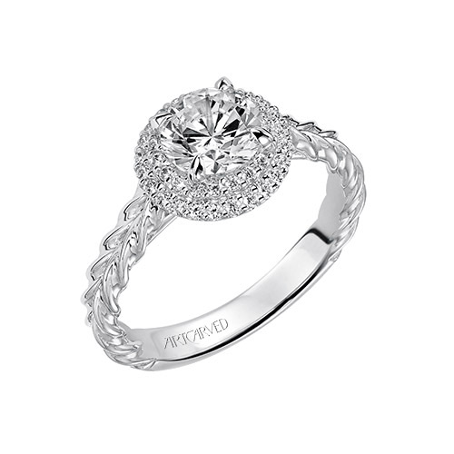 A halo engagement ring setting gives lots more sparkle to the diamonds.