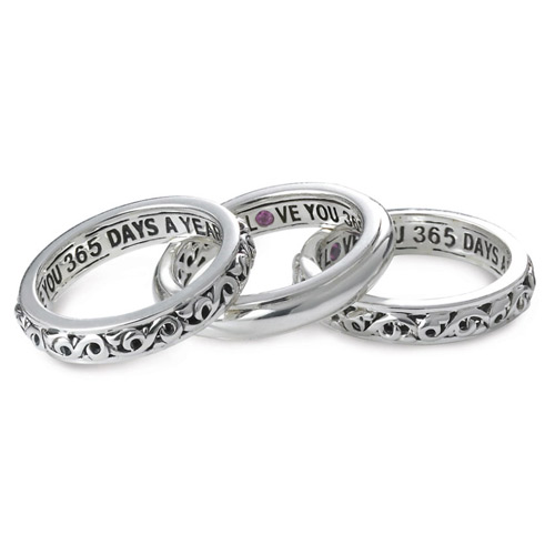 The three rings are inscribed with a love saying for Valentine's Day.