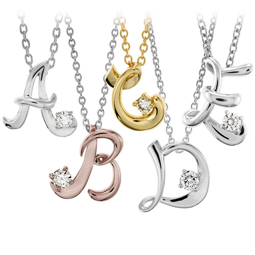 Hearts on Fire designed these initial pendants with diamonds.