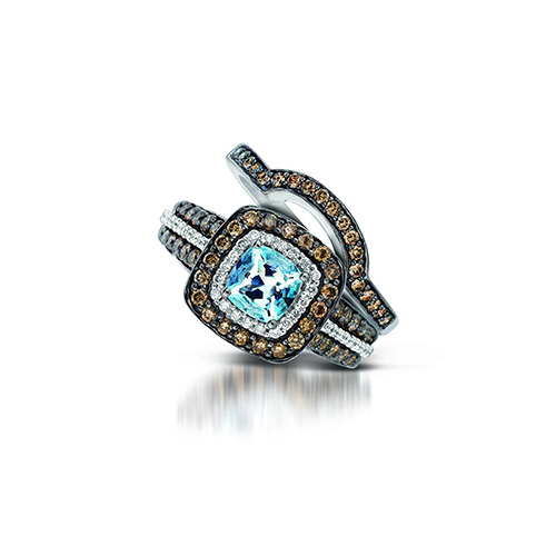A pretty combination of chocolate diamonds, white diamonds and a blue diamond.