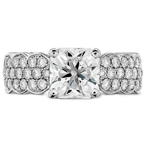 This diamond engagement ring is made with white gold and many carats of diamonds.