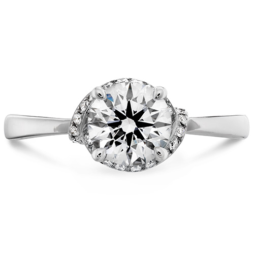 Optima feature a large center diamond, much like a solitaire and is made with white gold.
