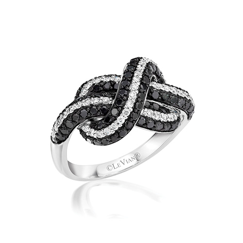 This ring looks like it is tied into a knot of black and white diamonds.