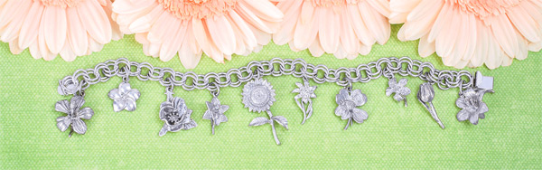 A great variety of silver charms for necklaces are available from Rembrandt.