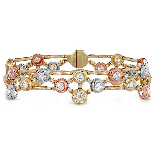 This diamond bracelet features gold, white and yellow gold.