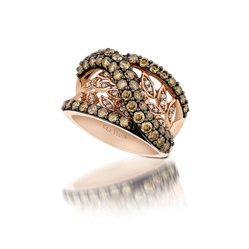 This diamond ring has an open design and features white and chocolate diamonds.