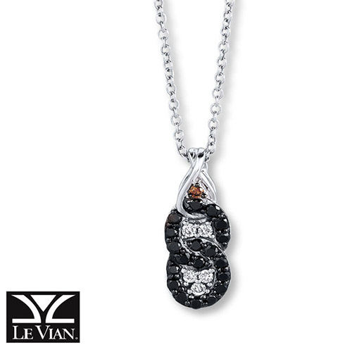This pendant features two loops of black diamonds and white diamonds.
