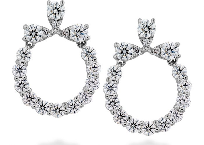 This beautiful pair of earrings has the powerful sparkle of Hearts on Fire diamonds.