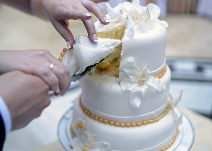 Reviving a new tradition, many brides are adding charms to their wedding cakes!