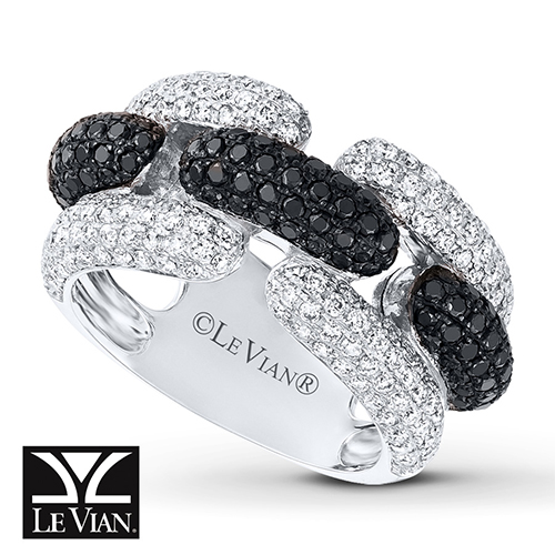 A ring featuring black diamonds and white diamonds.